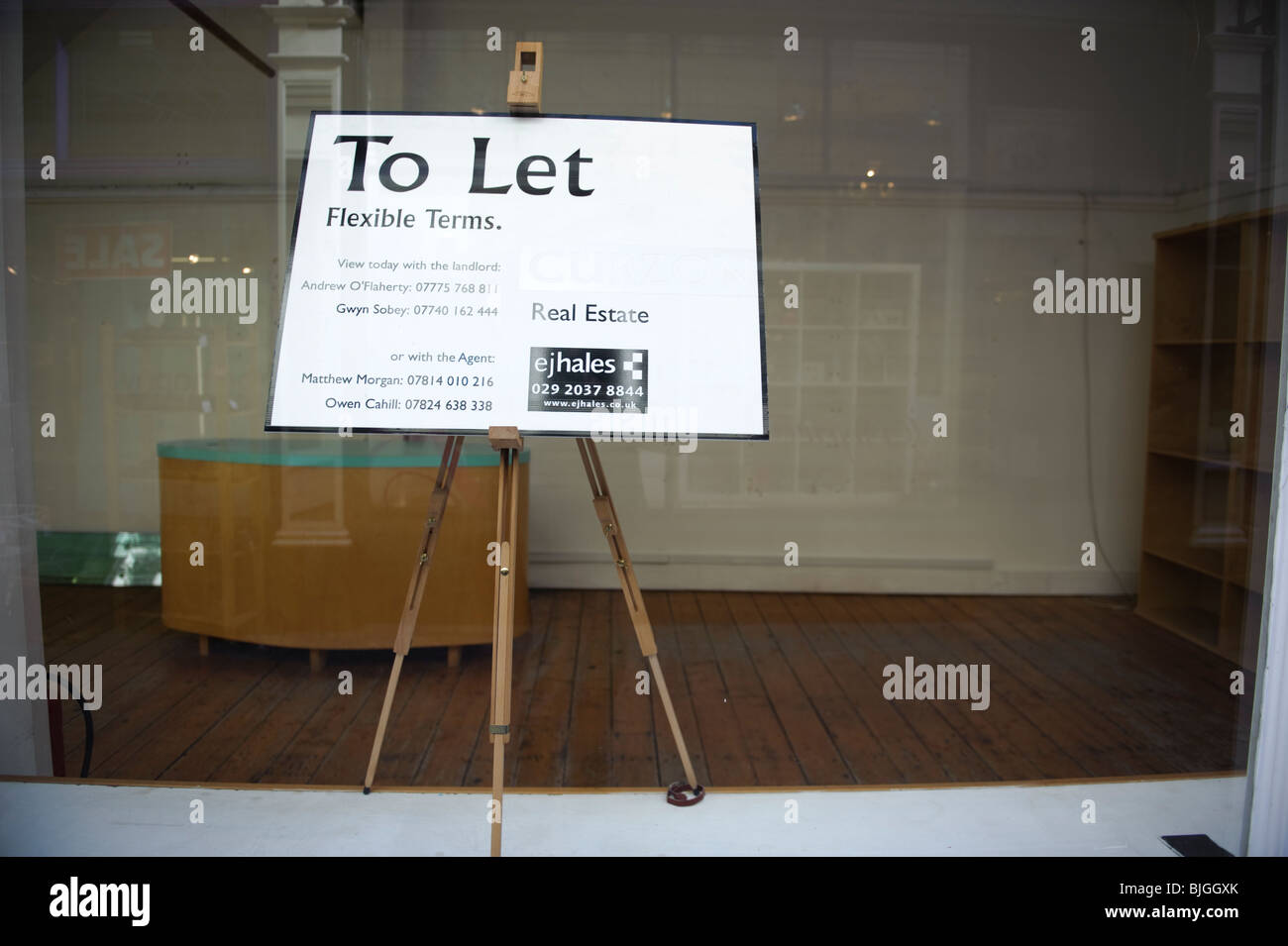 An empty office shop store to let sign in the centre of Cardiff Wales UK - Stock Image