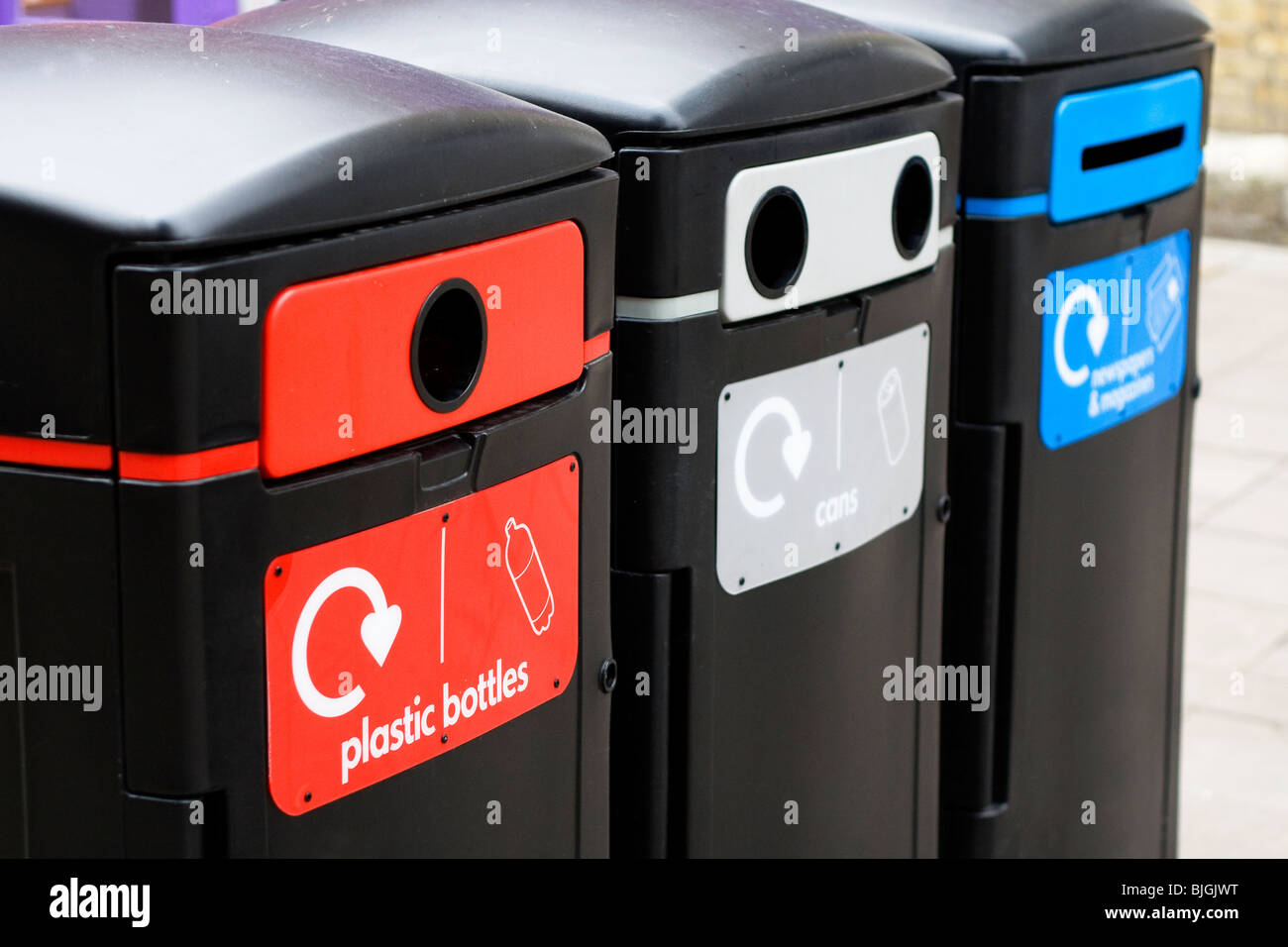 A row of recycling bins in a town centre Stock Photo