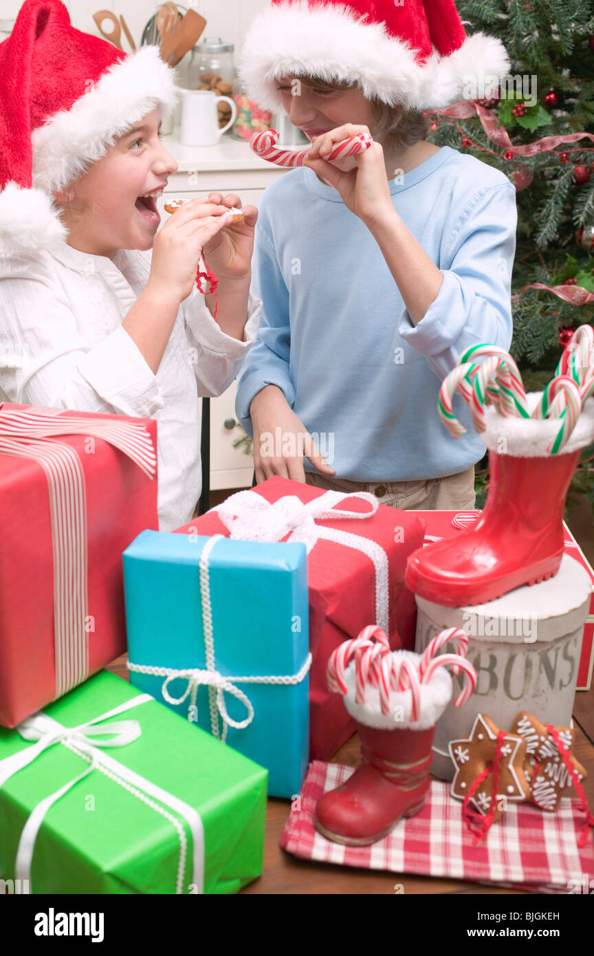 Sugar free gifts stock photos sugar free gifts stock images alamy girl and boy in father christmas hats with gifts stock image negle Images