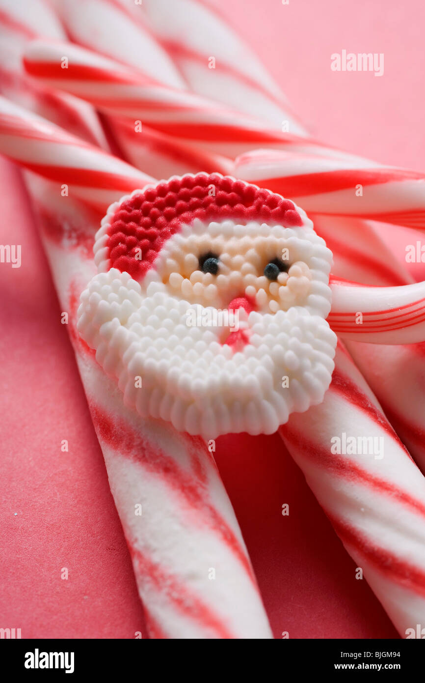 Father Christmas biscuits and candy canes (detail) - - Stock Image