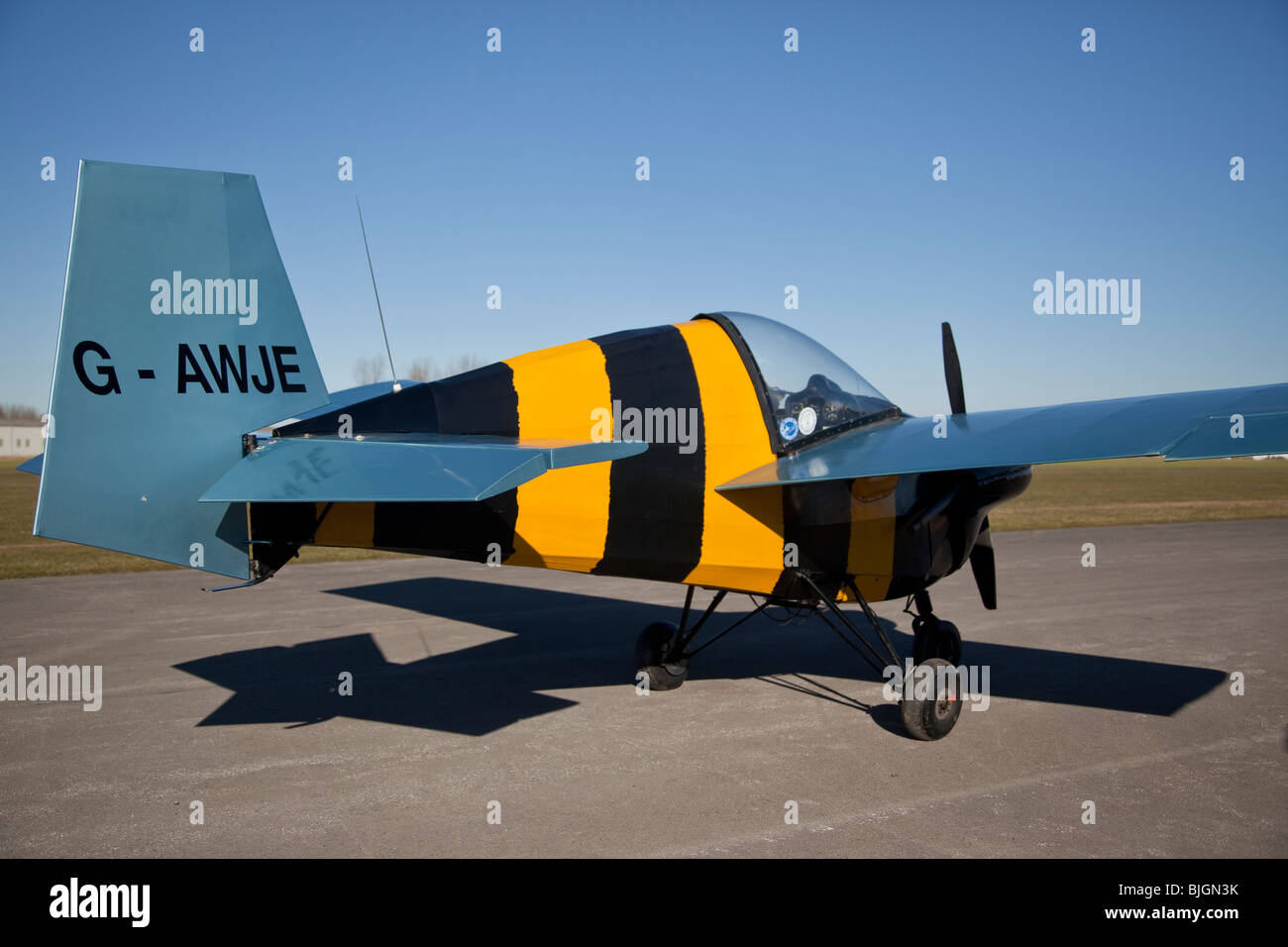 Slingsby Nipper, registered G-AWJE, and painted like a bumble bee, at Breighton - Stock Image
