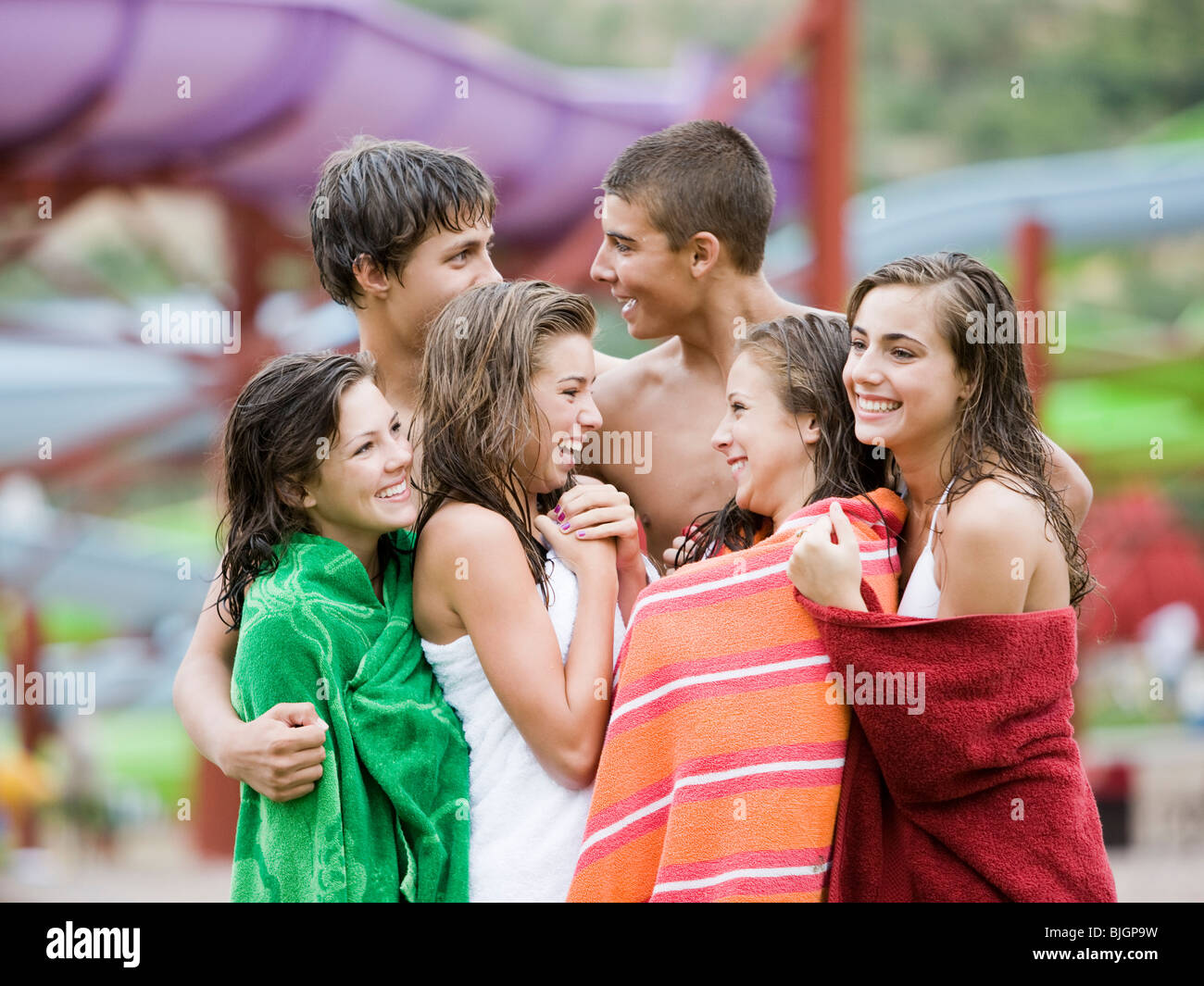 teenagers at a waterpark - Stock Image