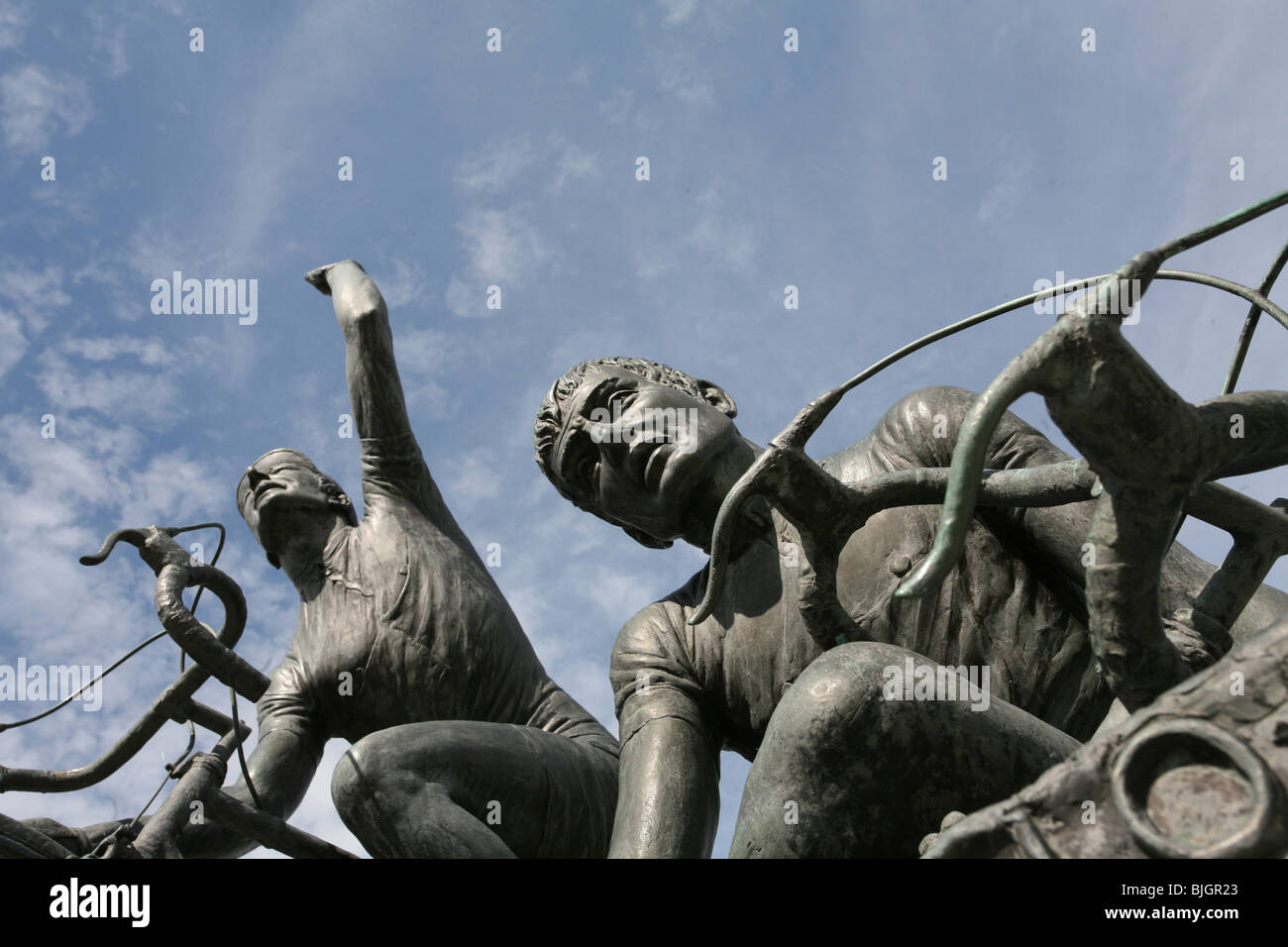 Picture of two bronze statues of cyclists, signifying Victory and Defeat. Memorials to famous Italian cyclists, - Stock Image
