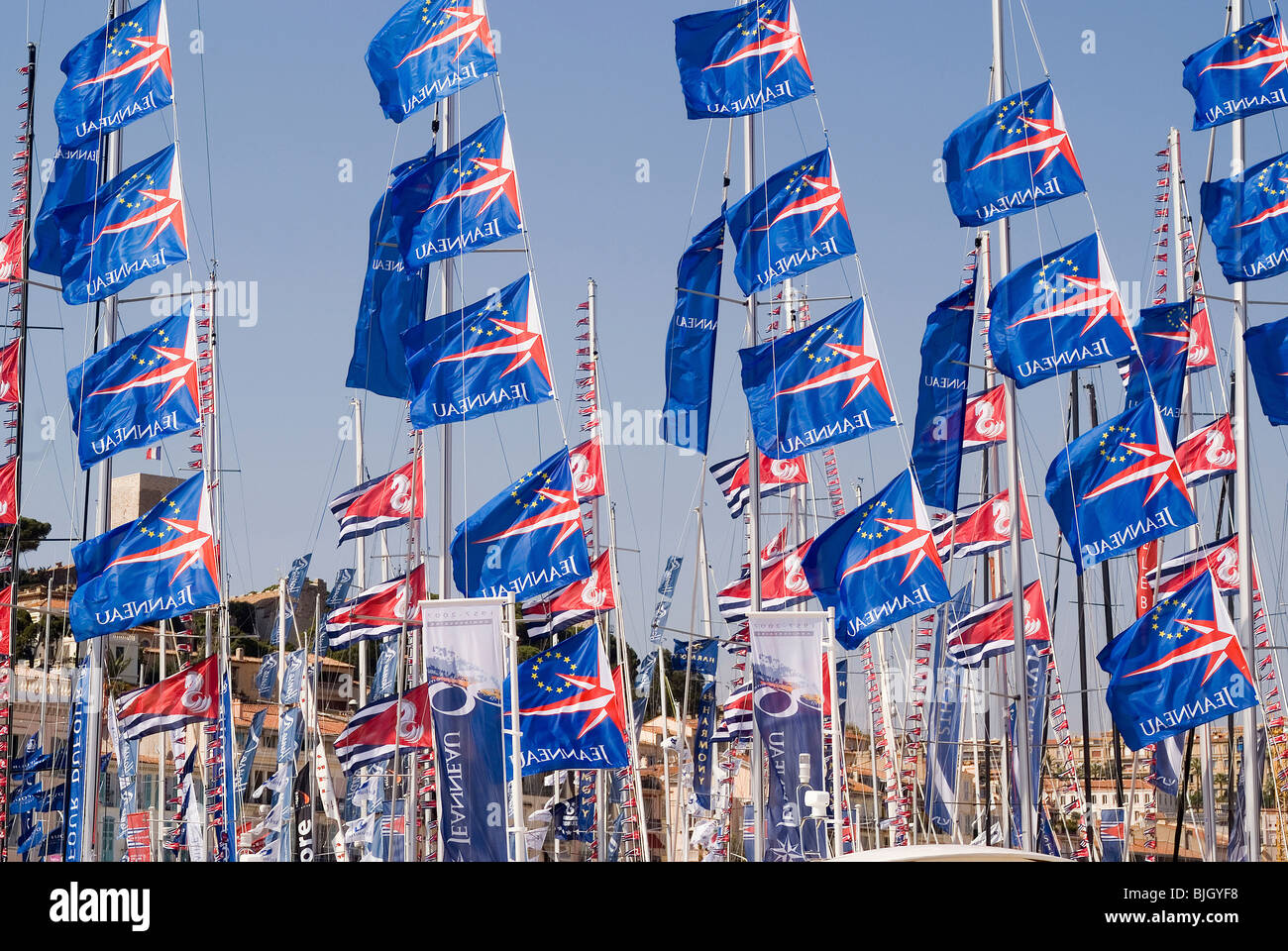 Blue flags fluttering in Vieux Port, Cannes, France - Stock Image