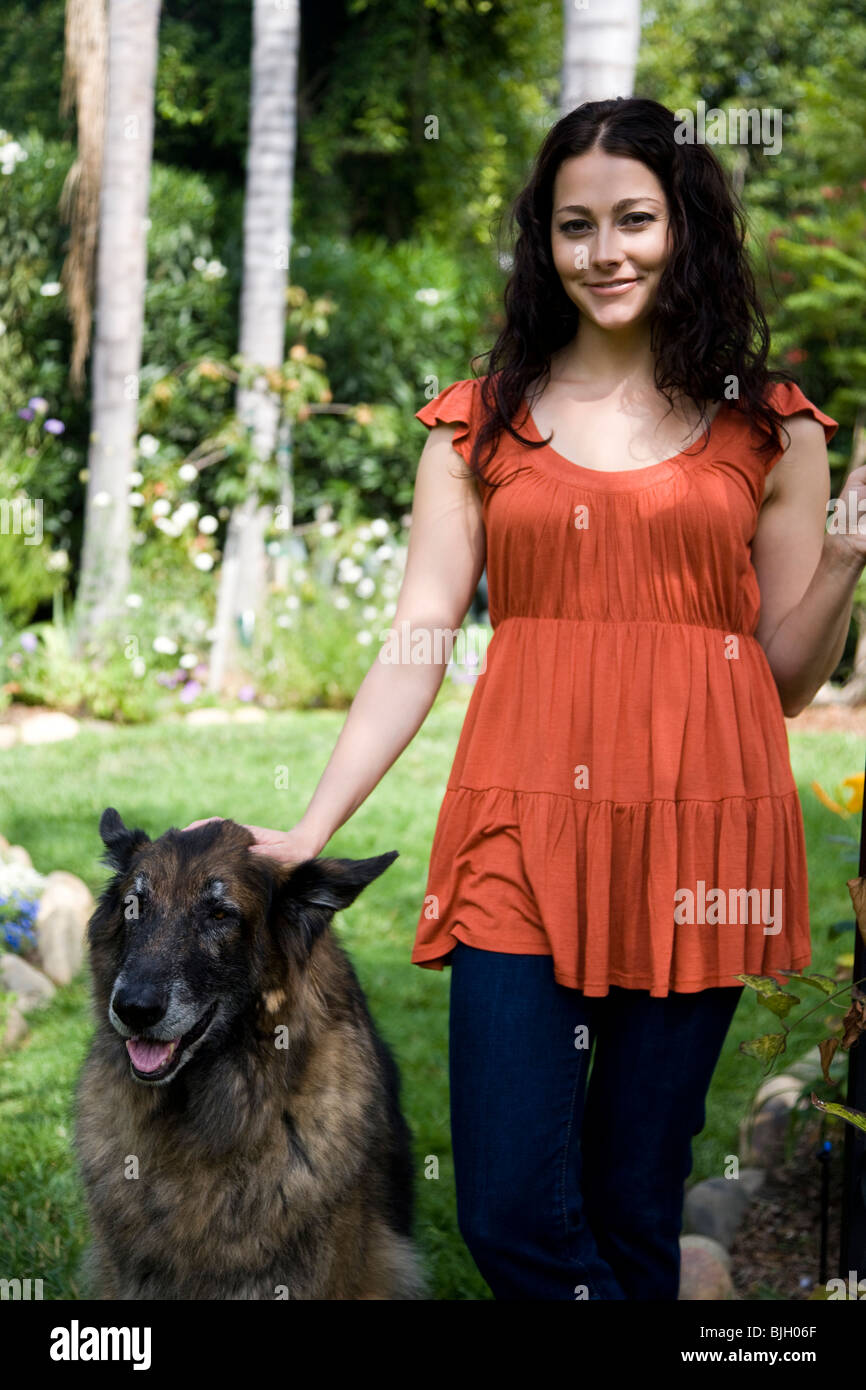 woman outdoors with her dog - Stock Image