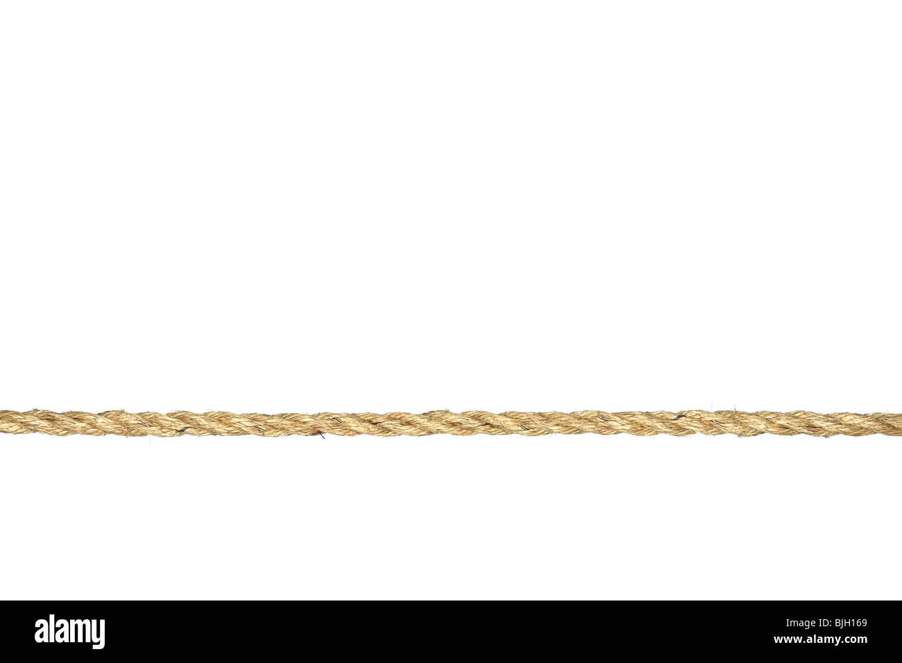 A straight line of twisted manila rope isolated on a white background. - Stock Image