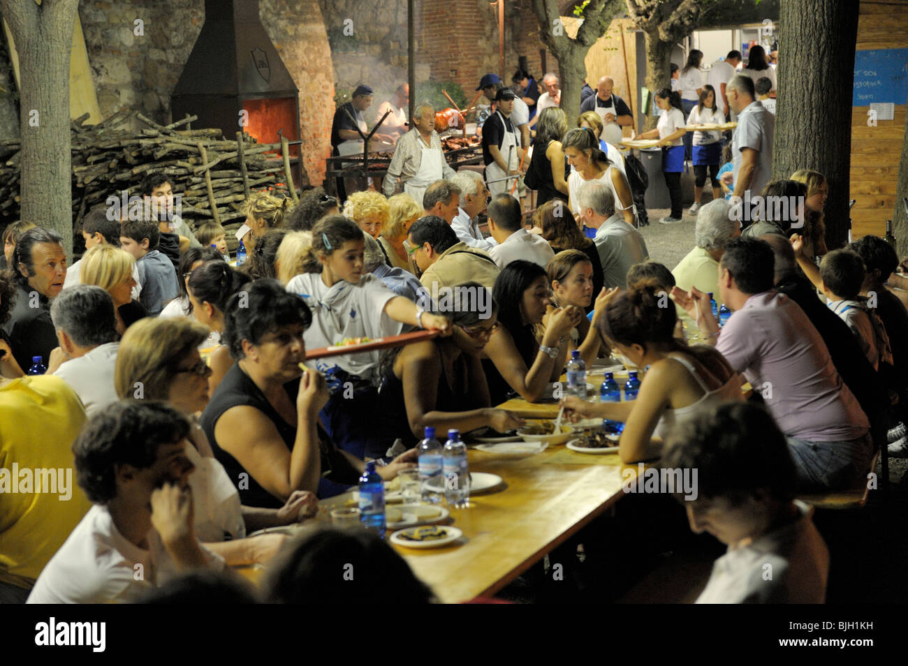 Montepulciano, Tuscany, Italy. Contrada district wild boar feast during the annual wine festival known as the Bravio Stock Photo
