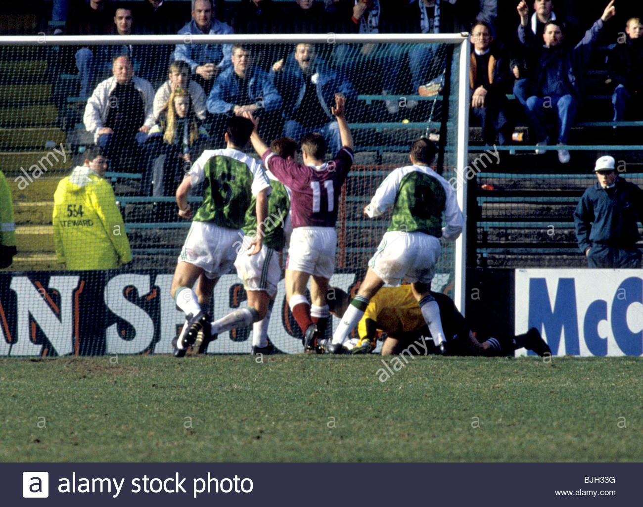 21/03/92 PREMIER DIVISION HIBS V HEARTS (1-2) EASTER ROAD - EDINBURGH John Robertson (11) celebrates after Hibs - Stock Image