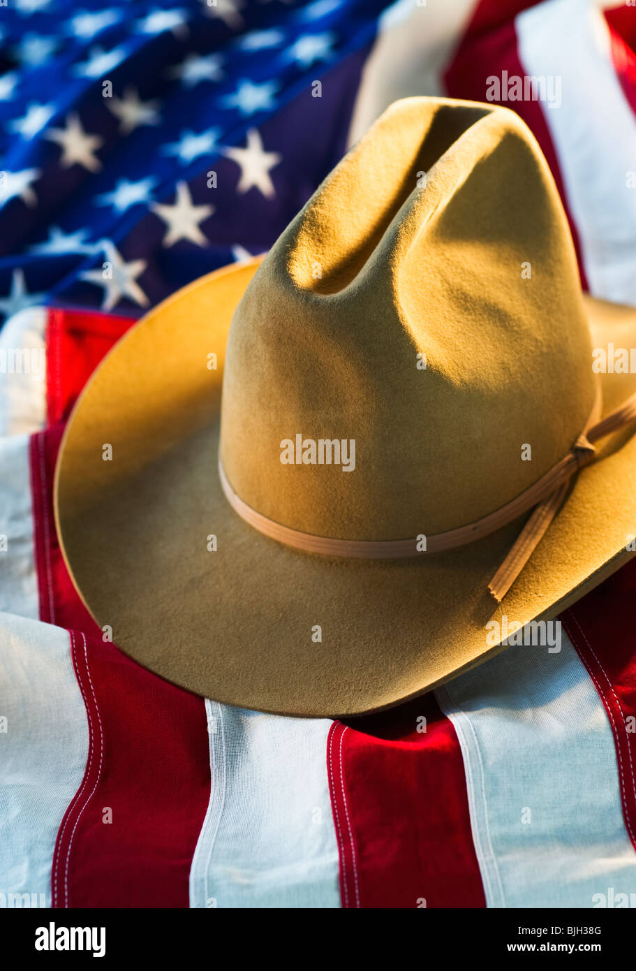 Cowboy hat on American flag - Stock Image