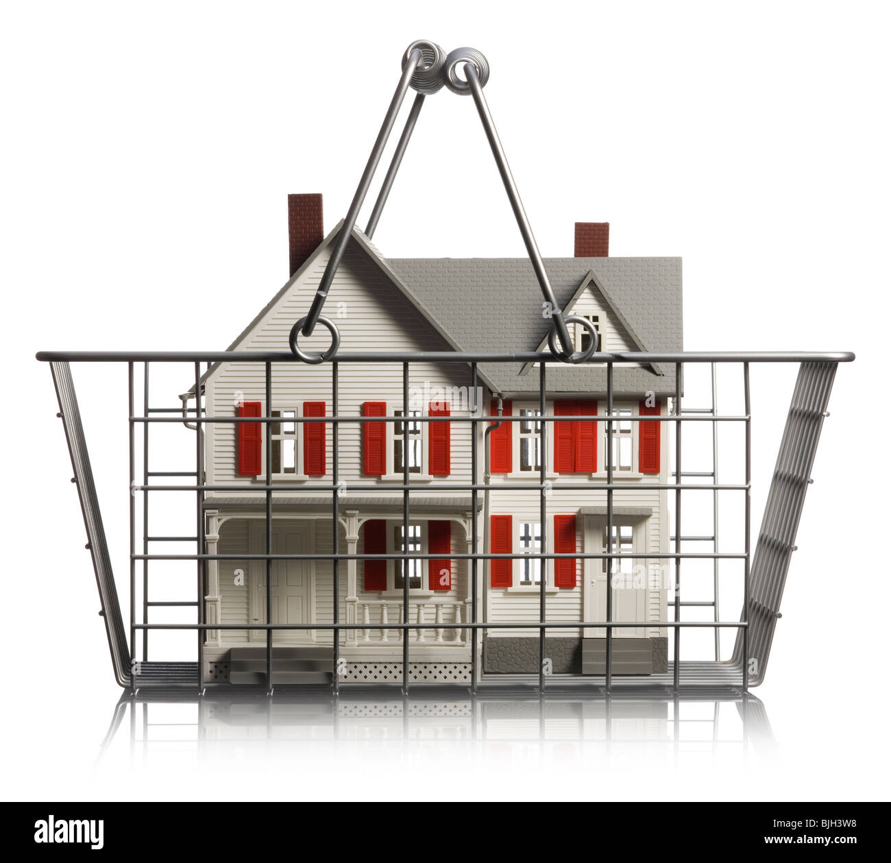 home up for sale in a shopping basket - Stock Image