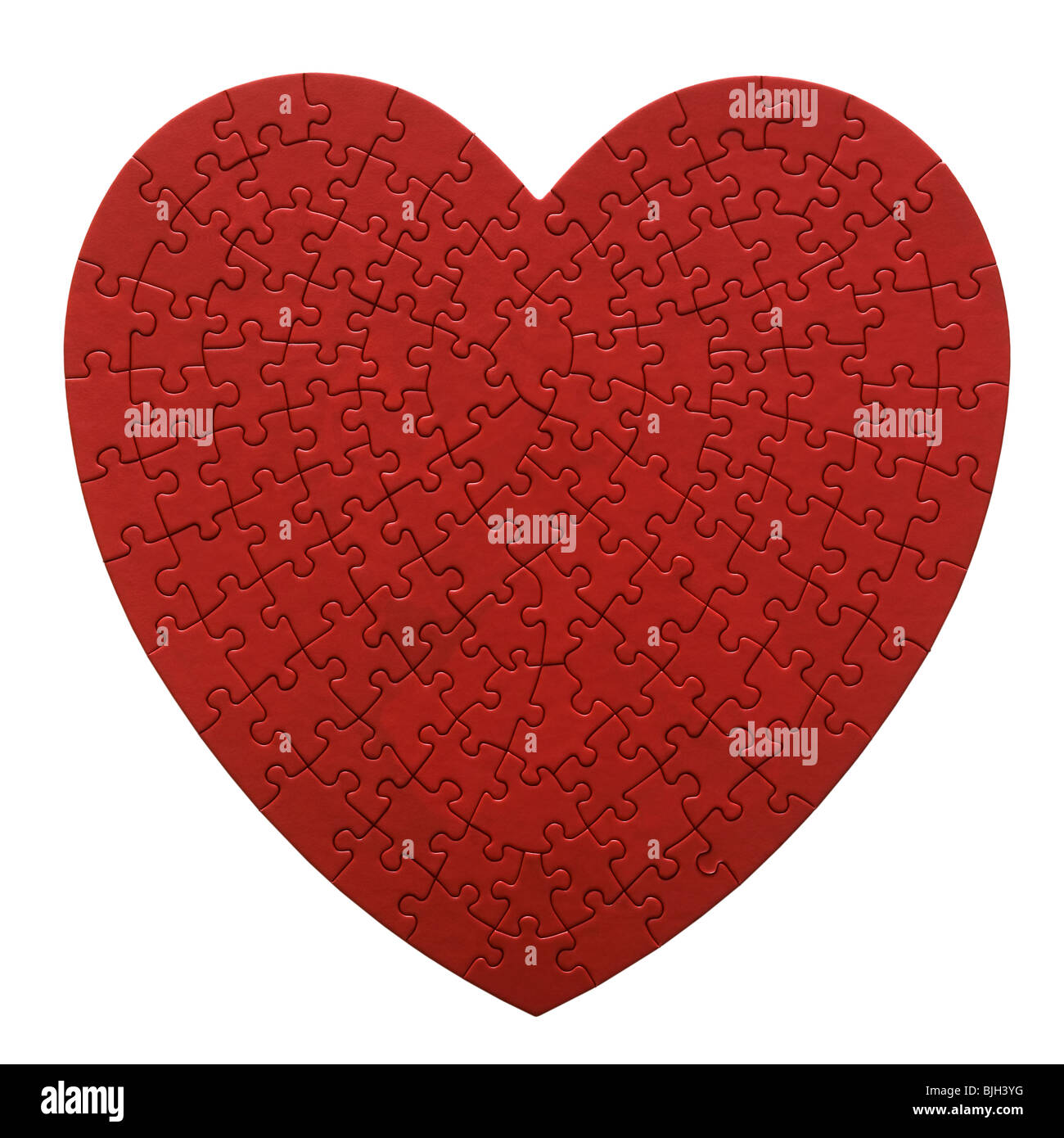 red heart shaped jigsaw puzzle on a white background Stock Photo