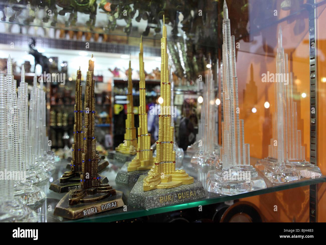 Reproductions of the Burj Dubai in a souvenir shop window, Dubai, United Arab Emirates - Stock Image