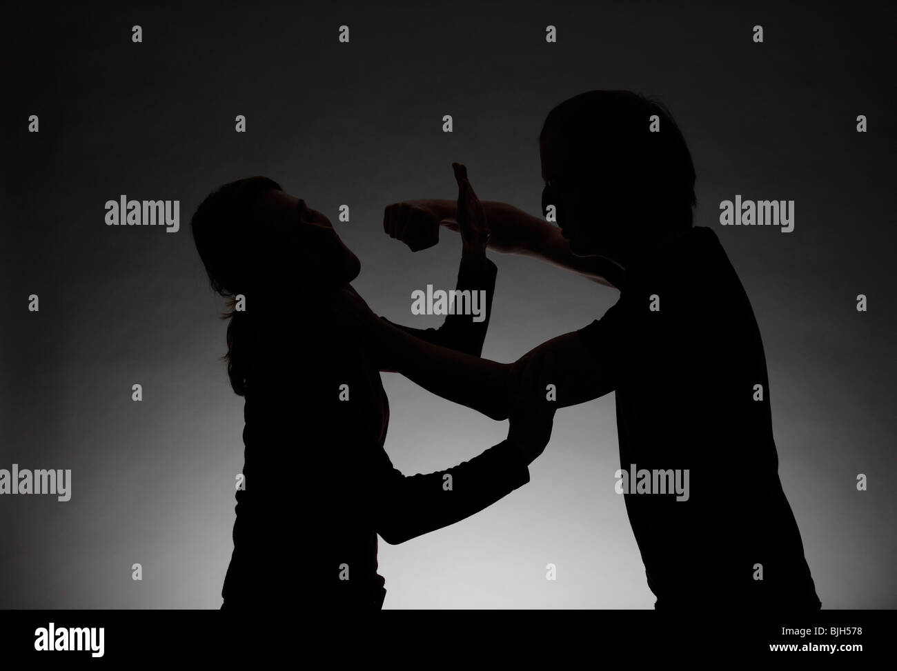 Man beating a woman. Symbol: violence between husband and wife, mistreatment, etc. - Stock Image