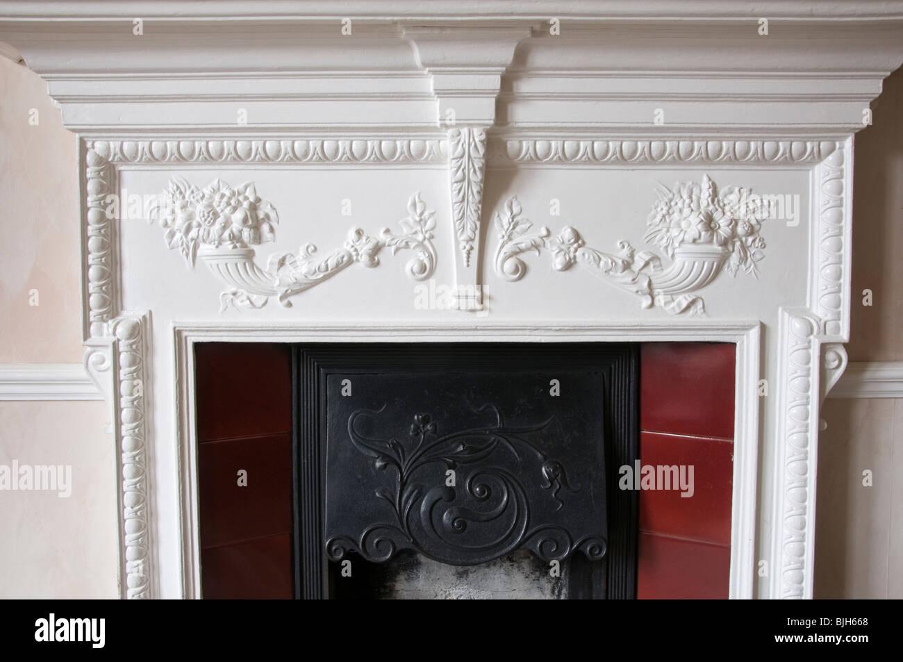 A Victorian cast-iron fireplace surround Stock Photo
