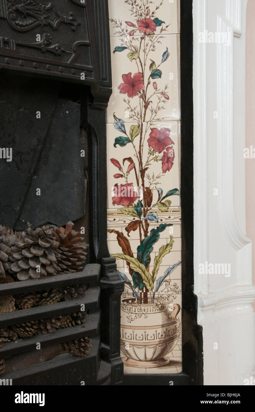 Decorative tiles forming part of a Victorian cast-iron fireplace - Stock Image