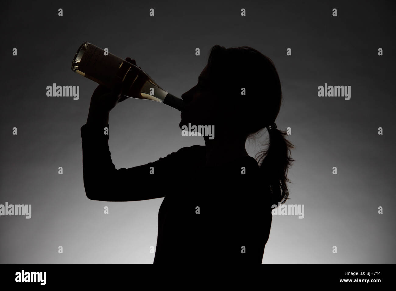 Woman drinking alcohol. Symbol: alcohol abuse, addiction - Stock Image
