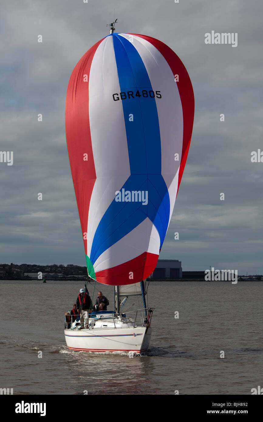Sailing Yacht Catch 22 racing on river Mersey - Stock Image