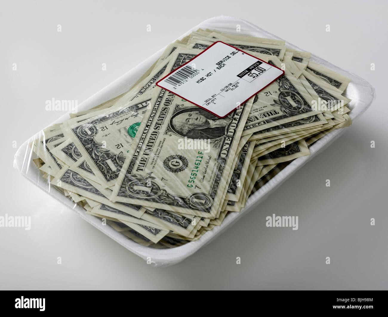 us dollars in a supermarket shrinkwrap package - Stock Image
