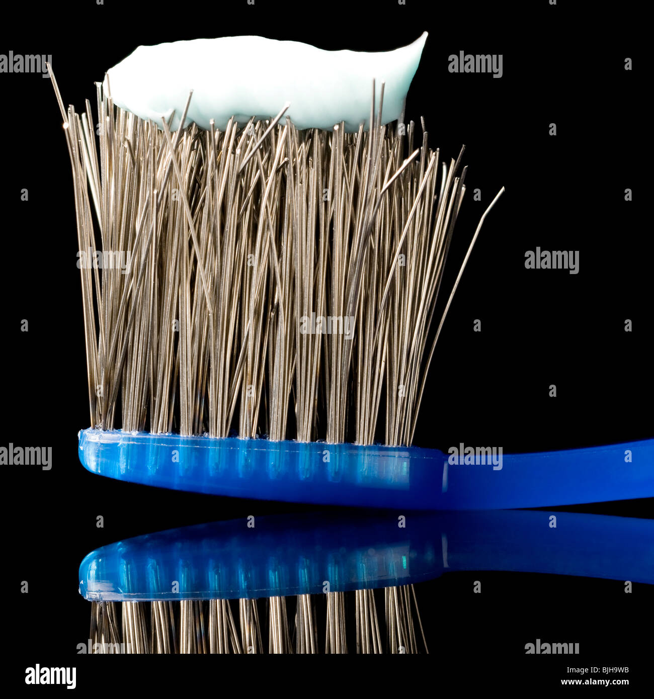 toothbrush with the bristles made of metal wires - Stock Image