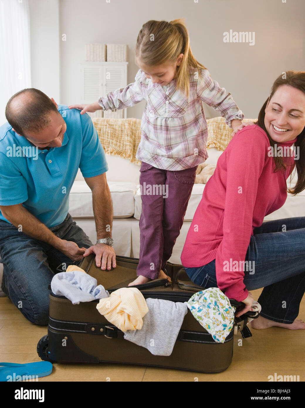 Packing for family vacation - Stock Image