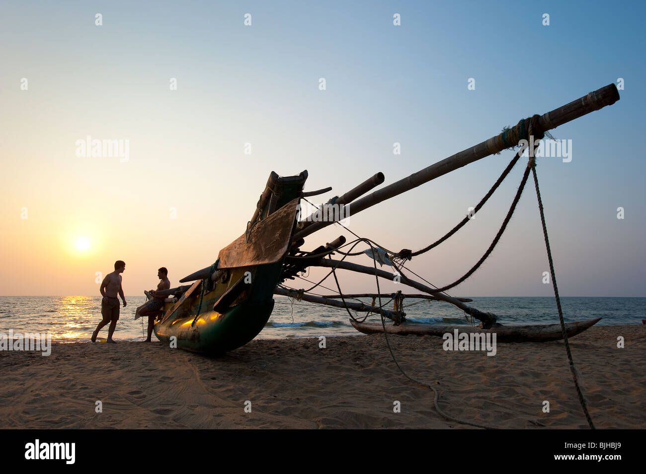 Sunset with Catamaran, Negombo Beach, Sri Lanka - Stock Image