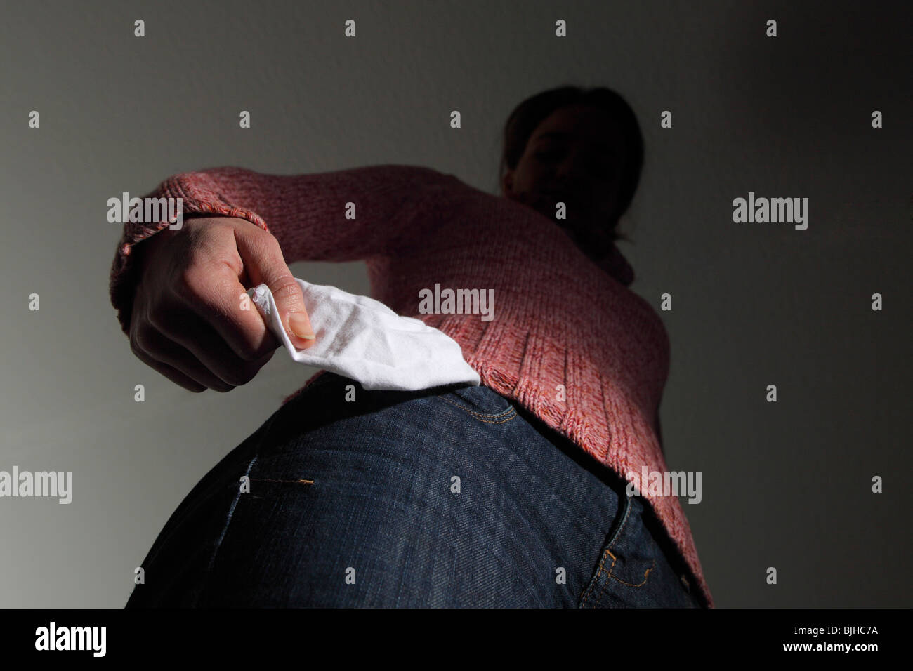 Woman with empty pockets. Symbol: insolvency, bankruptcy, etc - Stock Image