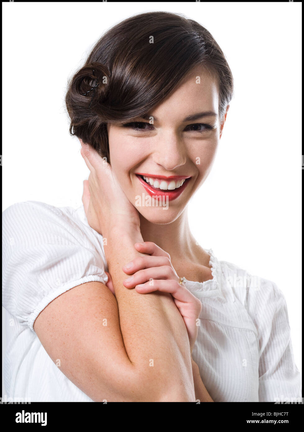 woman with her hair up in a classic hollywood hairstyle reminiscent of the 1940s - Stock Image