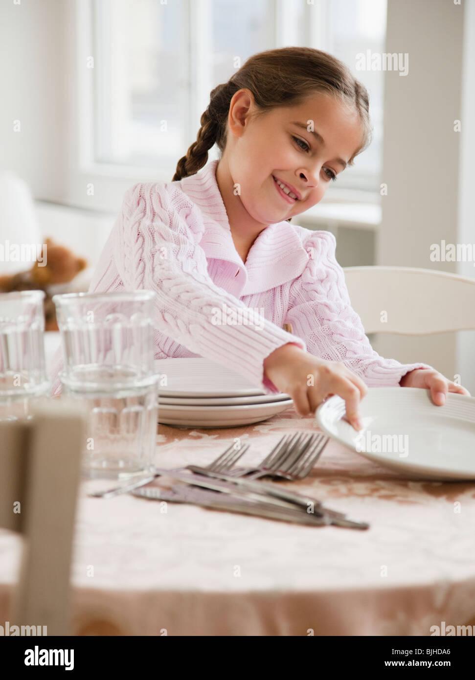 Young Girl Setting Table Stock Photo Alamy