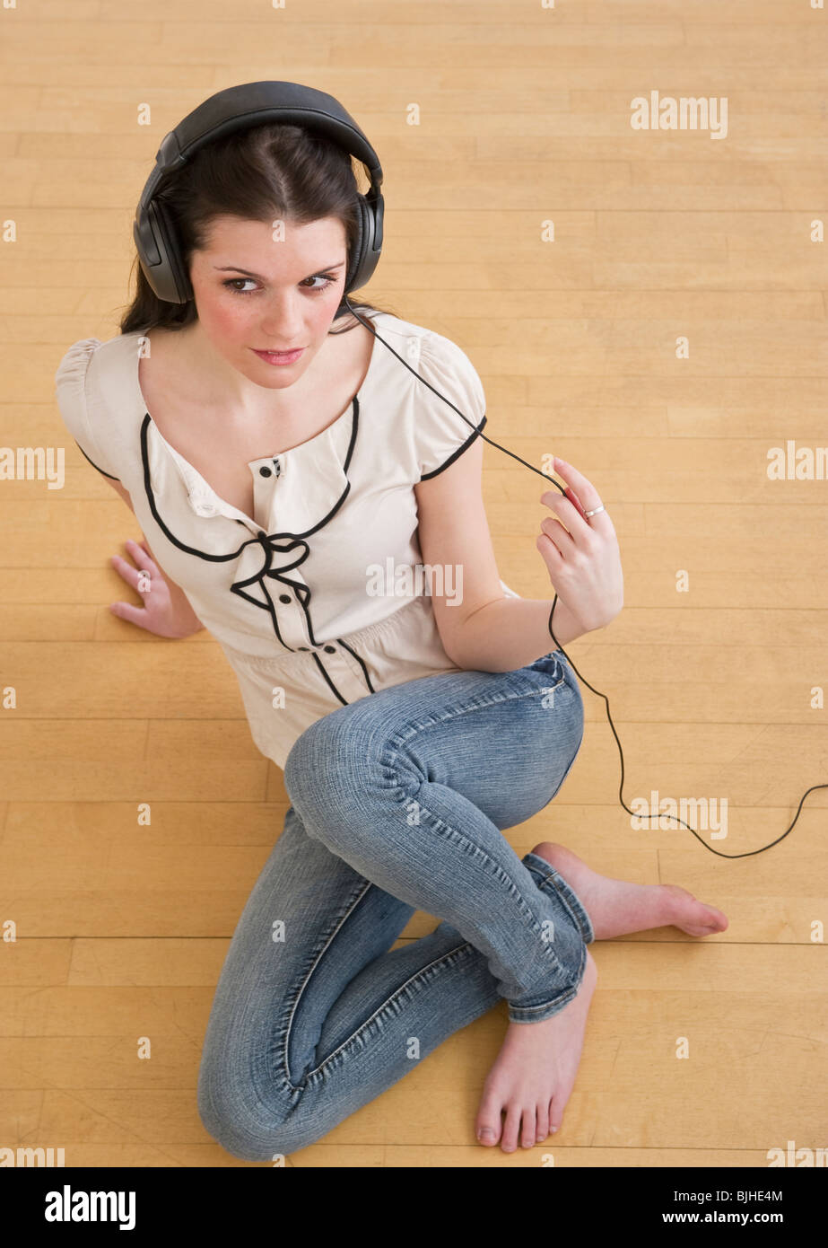 Woman wearing headphones - Stock Image