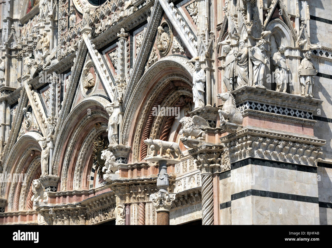 Sienna Cathedral, Tuscany, Italy. The candy-striped main façade of the duomo adorned with beasts and intricate - Stock Image