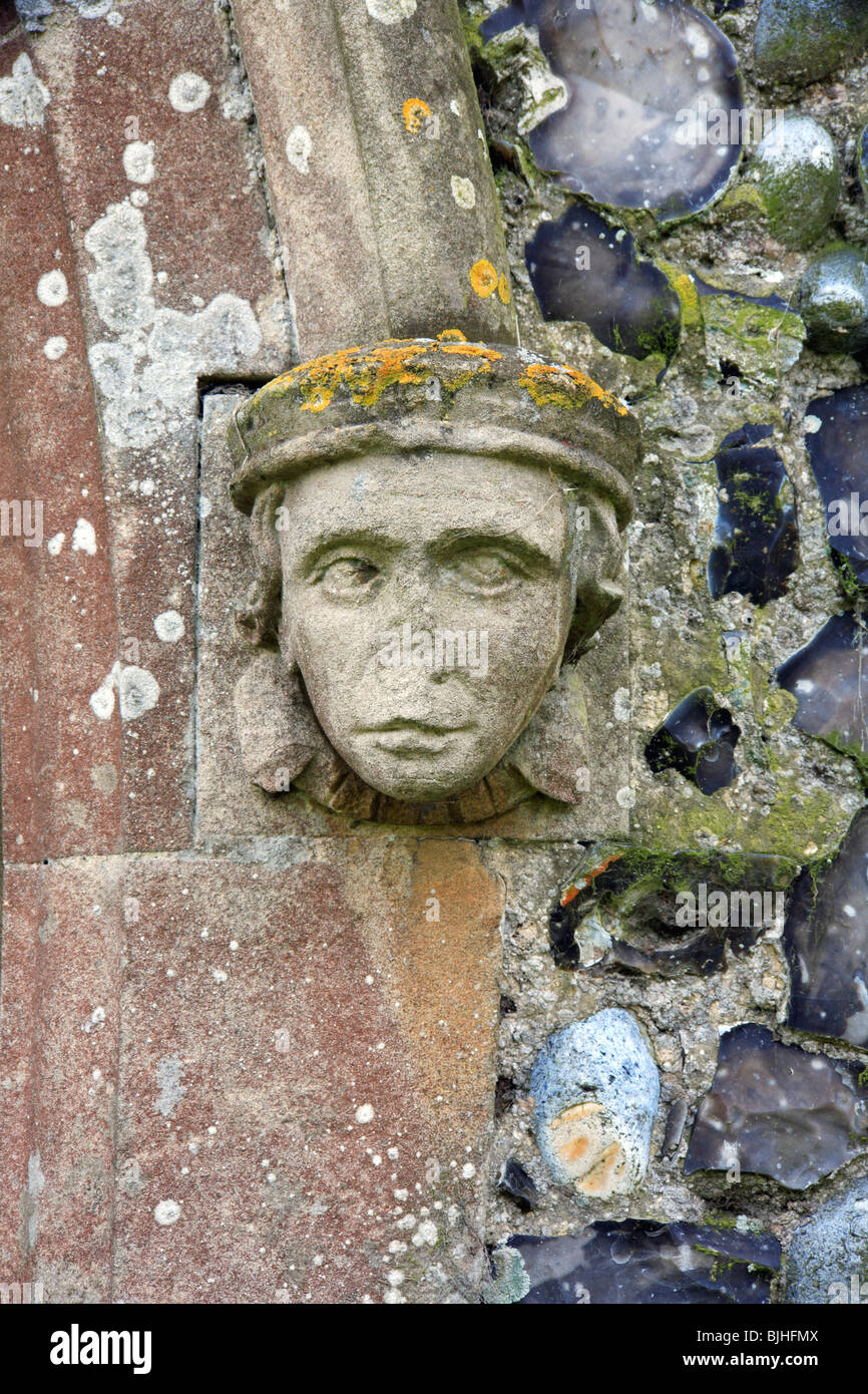 An effigy of a face in stone at the entrance to the north porch of the Church of All Saints at Filby, Norfolk, United Stock Photo