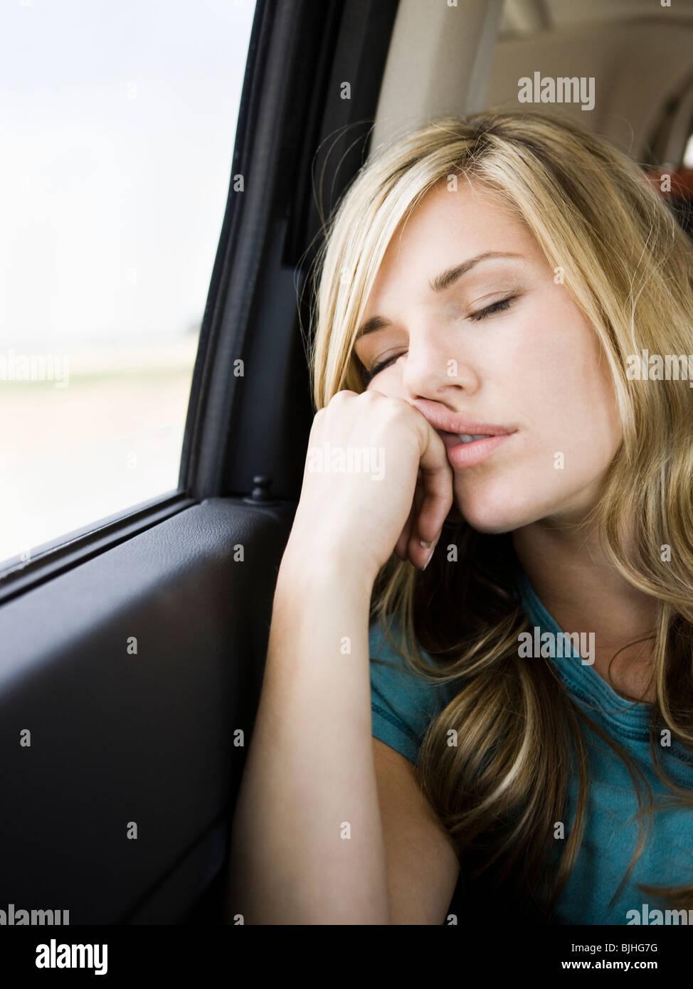woman sleeping in the car - Stock Image