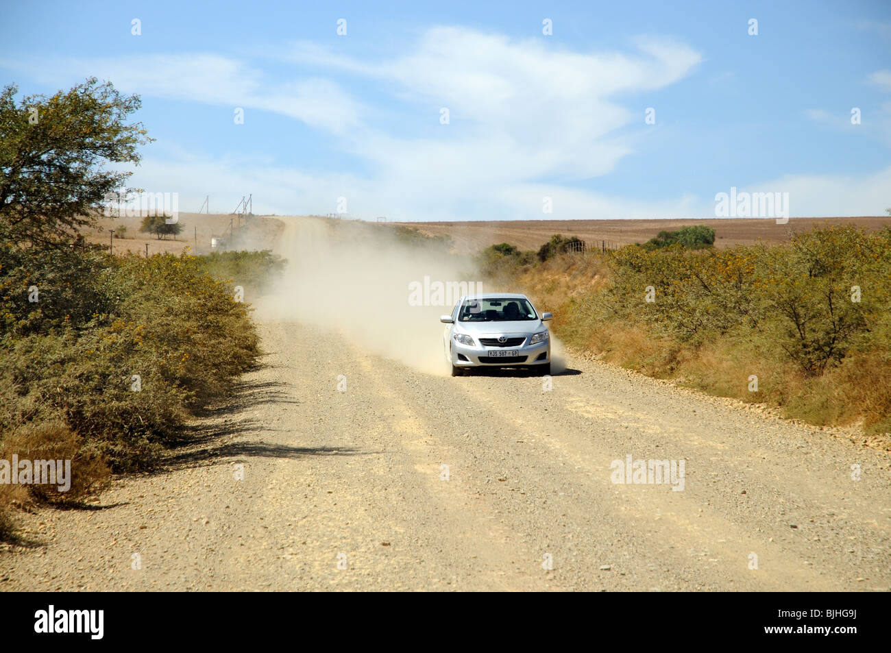 Motoring along the Garden Route. One of the may gravel roads encountered in southern Africa Toyota is heading toward - Stock Image