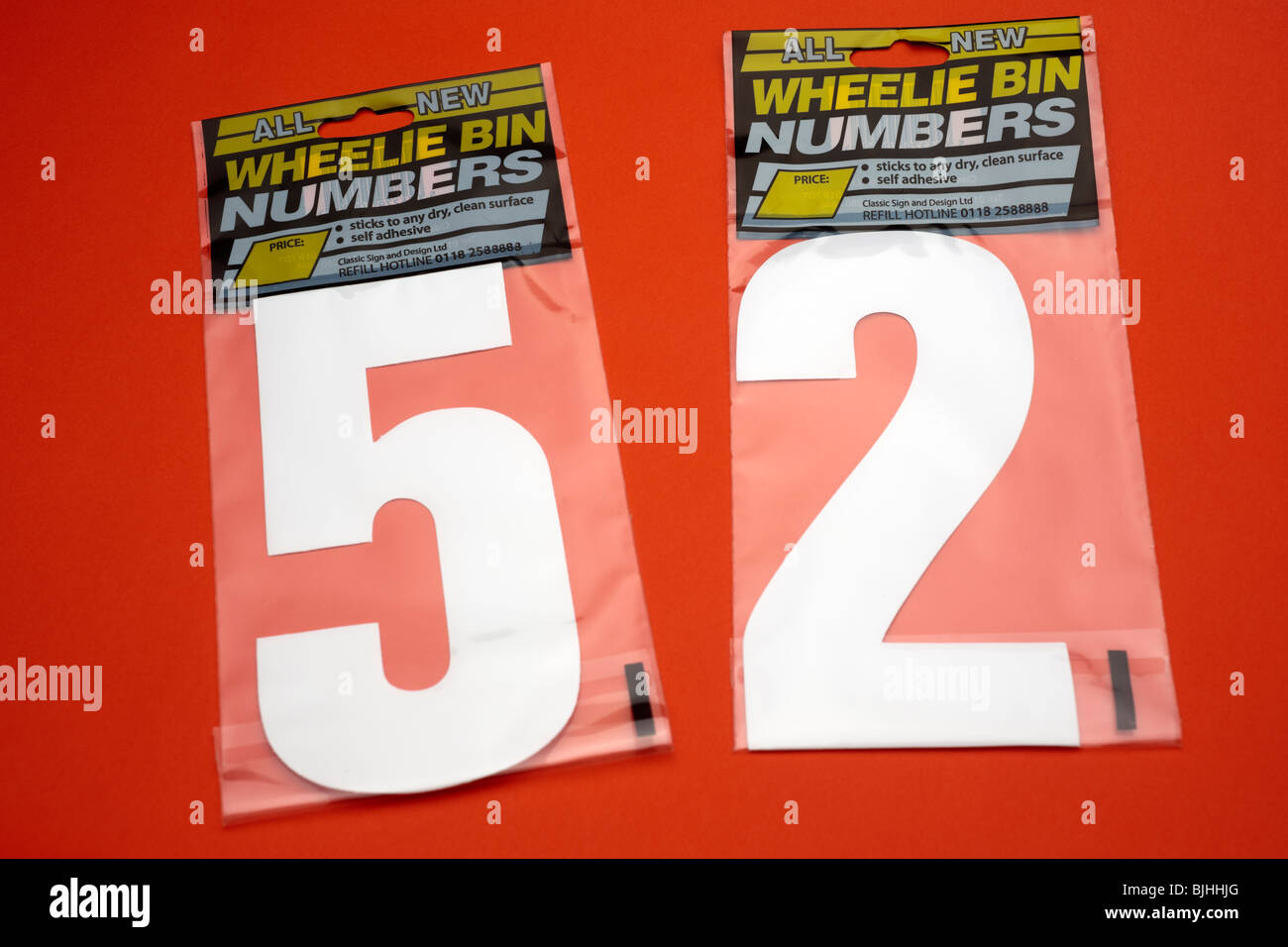 Two packs of wheelie bin numbers fifty two - Stock Image