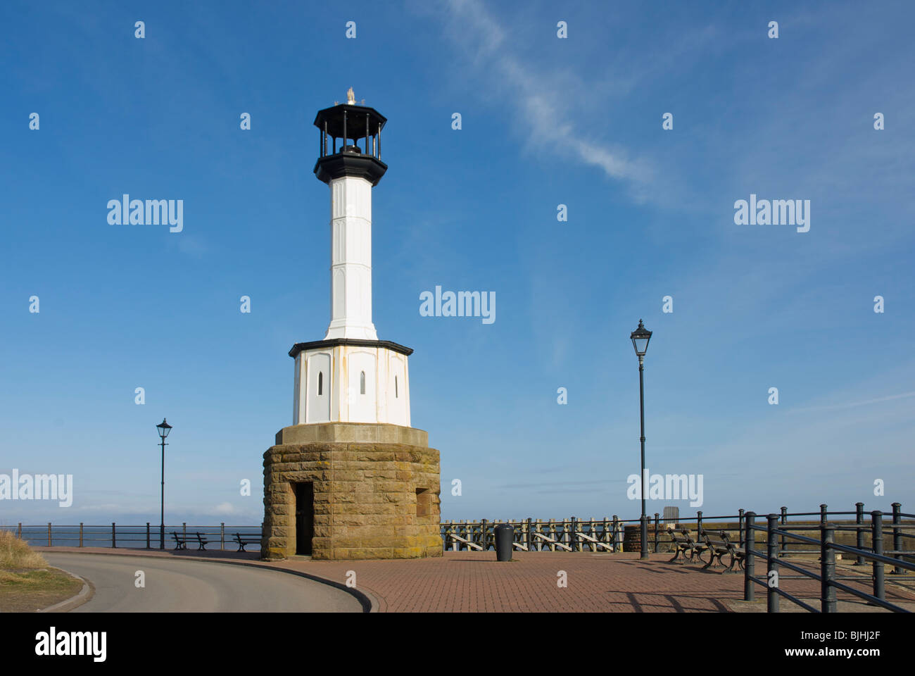 Lighthouse on the quay at Maryport, West Cumbria, England UK - Stock Image