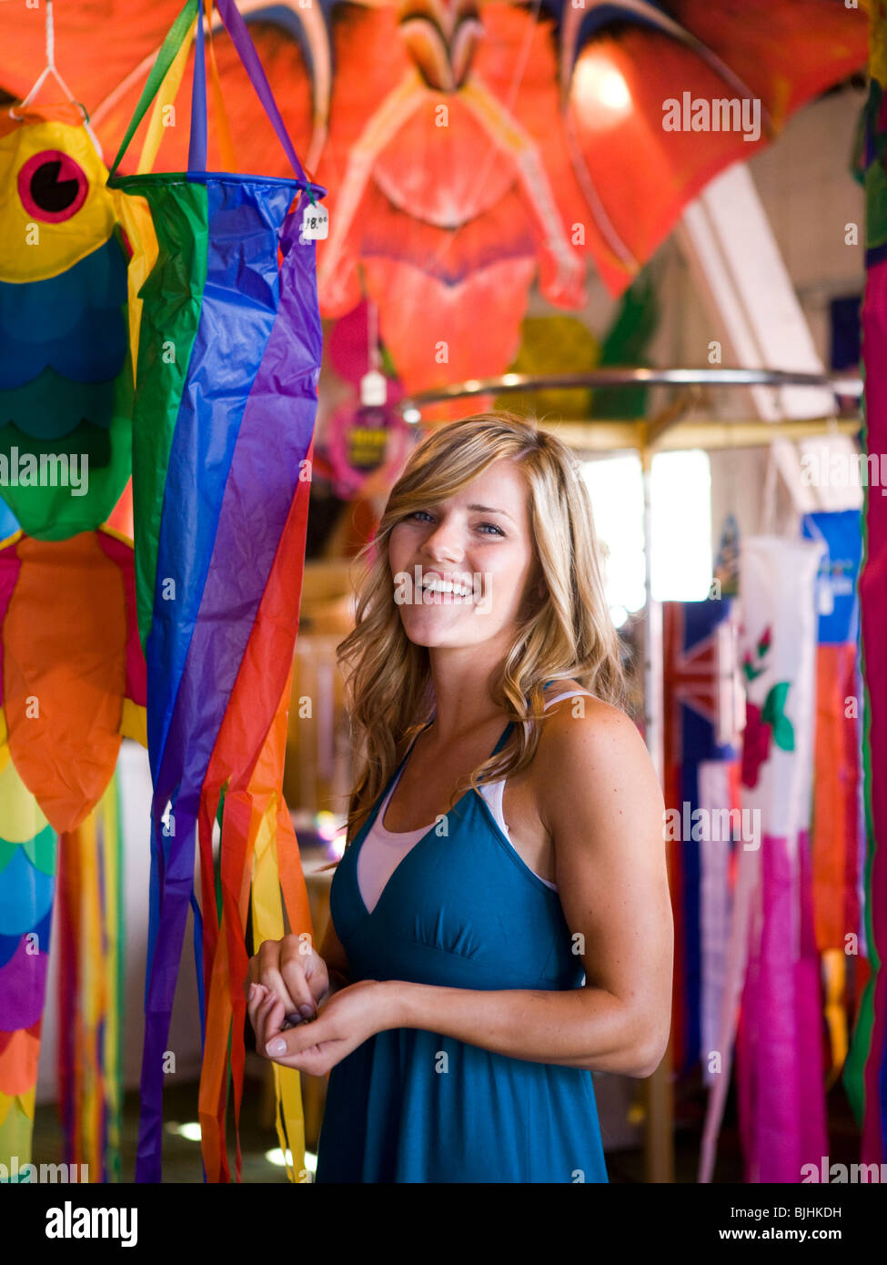 woman in a kite store - Stock Image