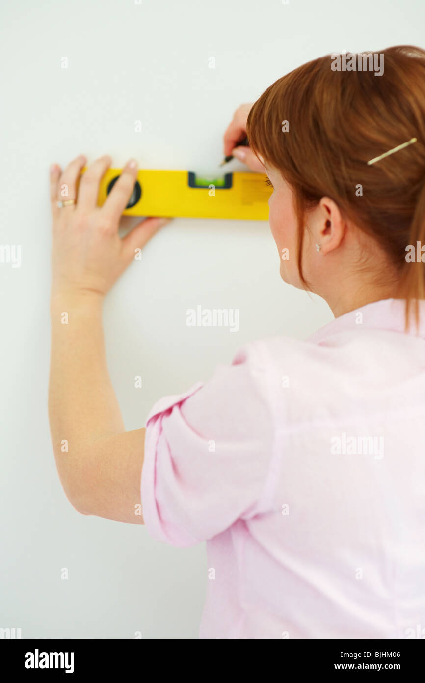 Woman using a level - Stock Image