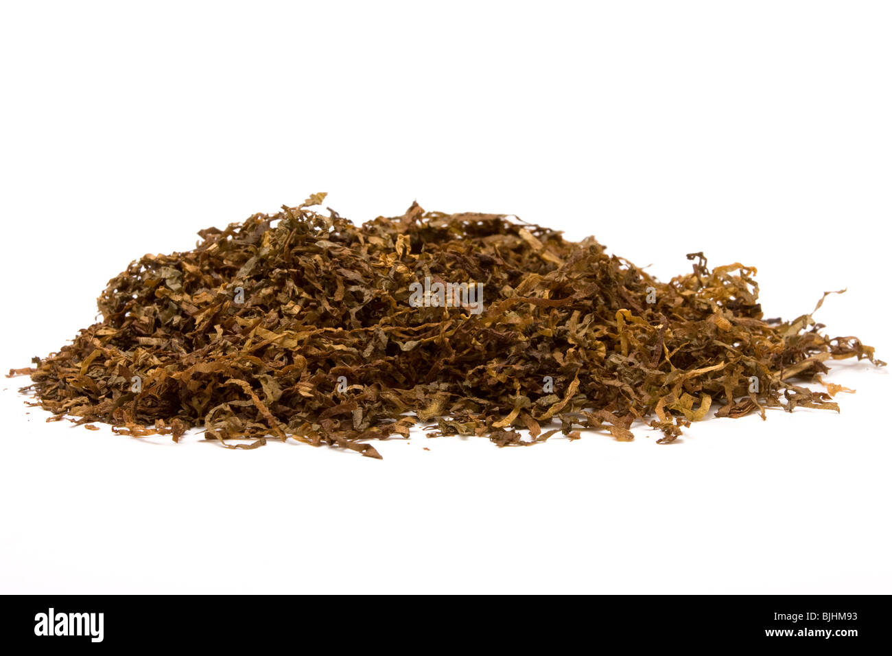 Pile of shredded cigarette Tobacco against white backdrop. - Stock Image