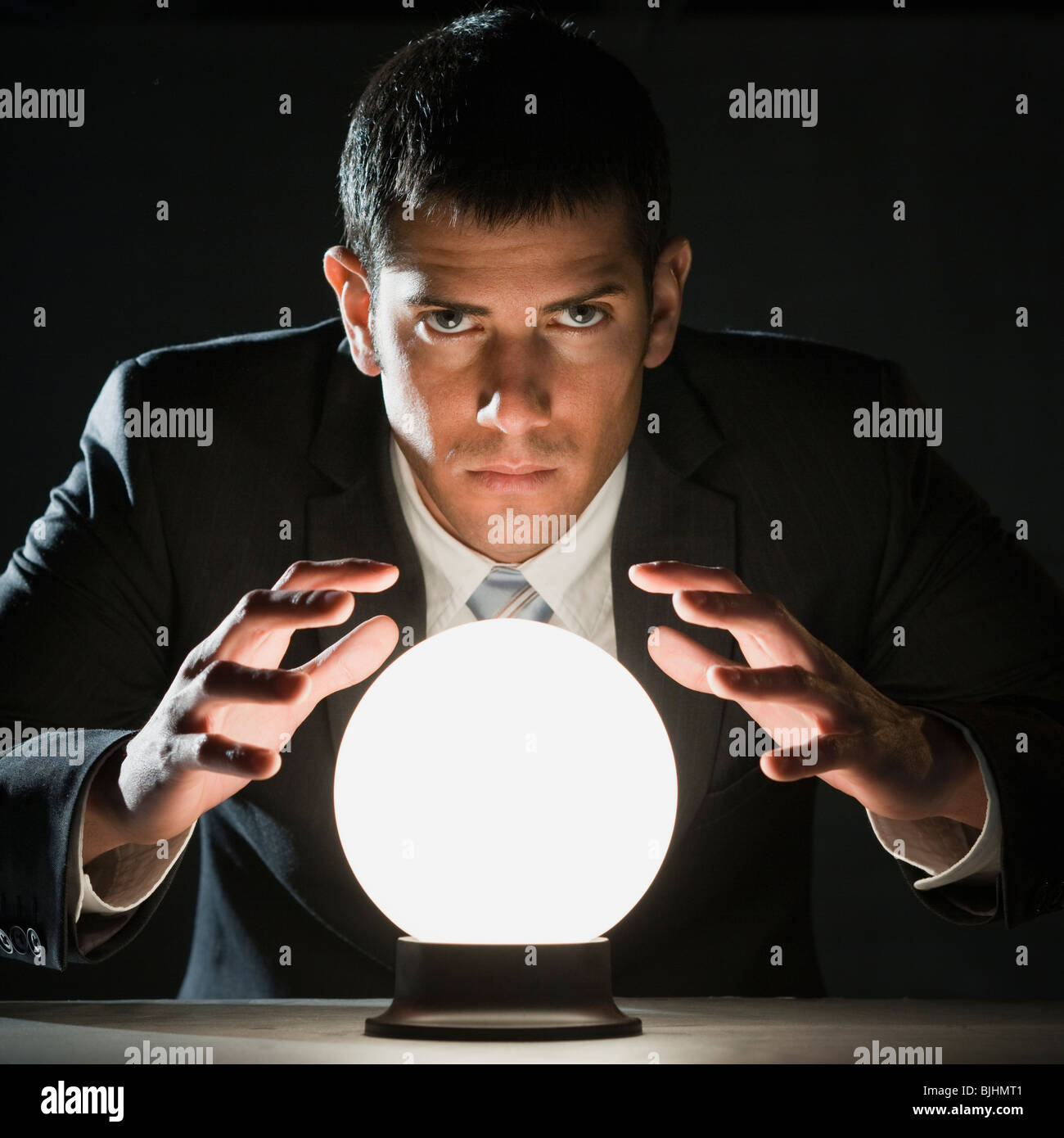 businessman with crystal ball - Stock Image
