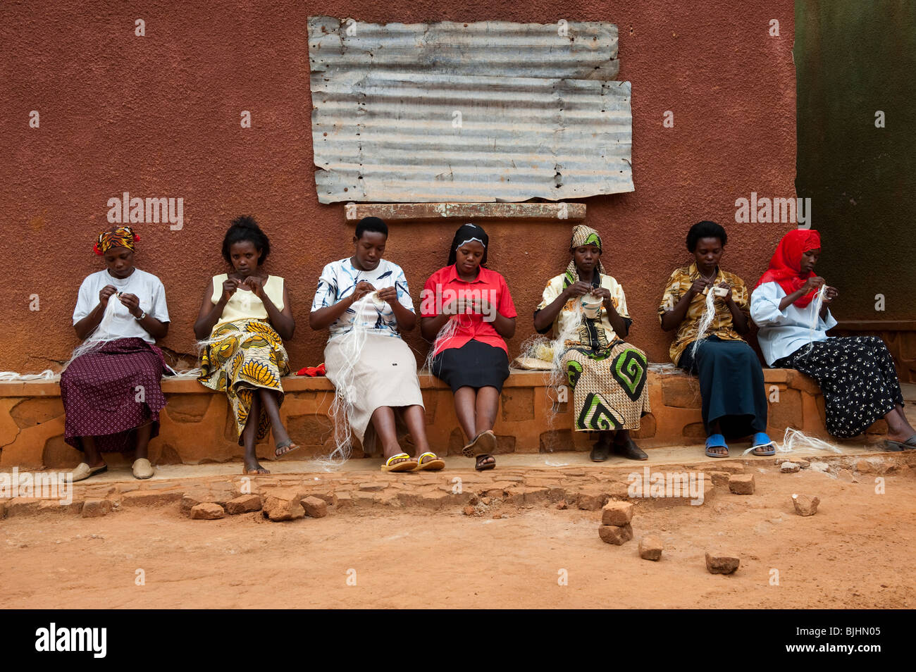 Ladies group working together, weaving produce to sell at local markets for thier Co-Op, Rwanda - Stock Image