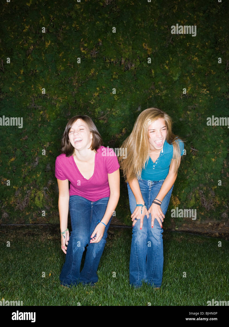 two friends in the backyard at night - Stock Image