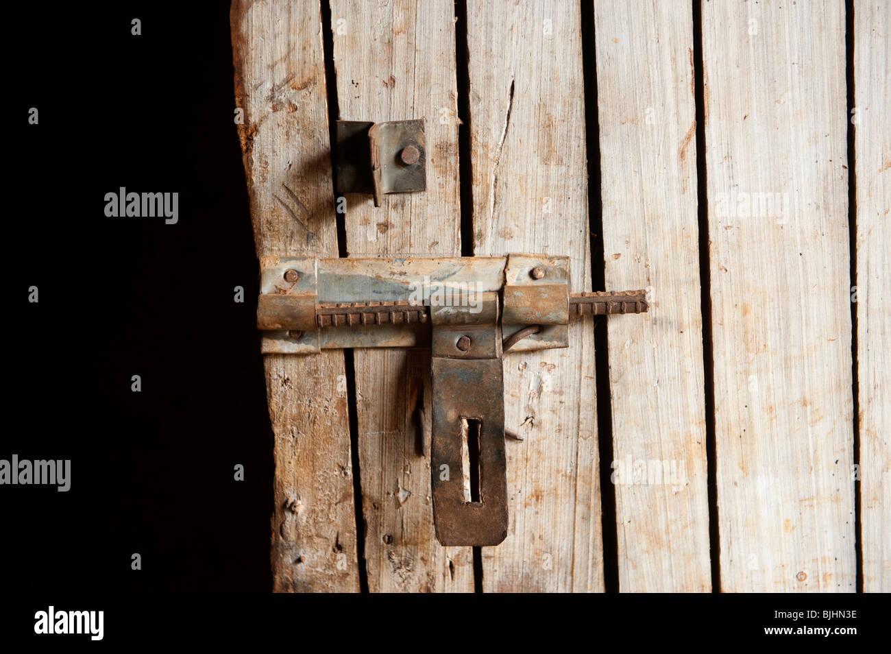 Wooden door and bolt. Rwanda. - Stock Image