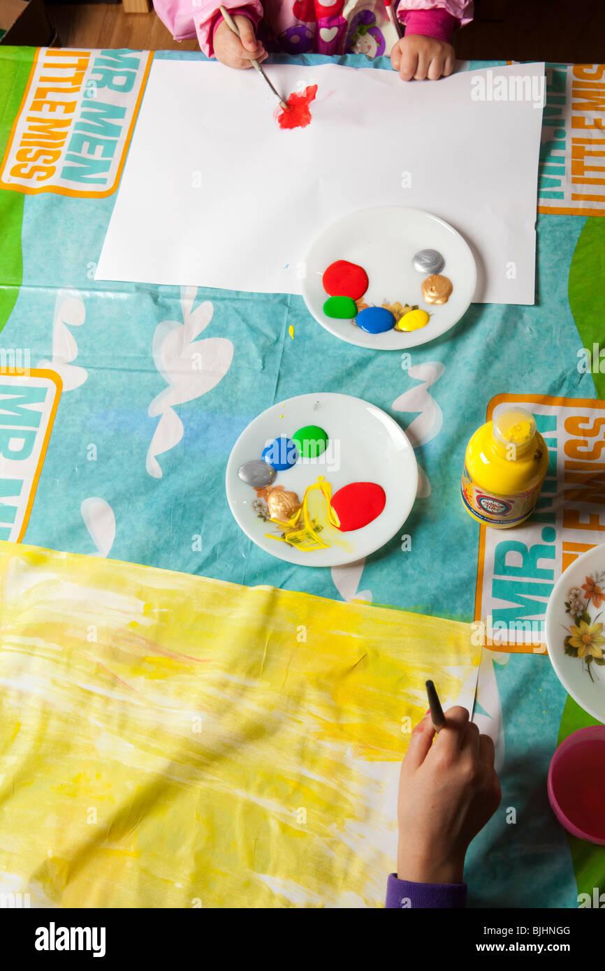Children paint in nursery Stock Photo