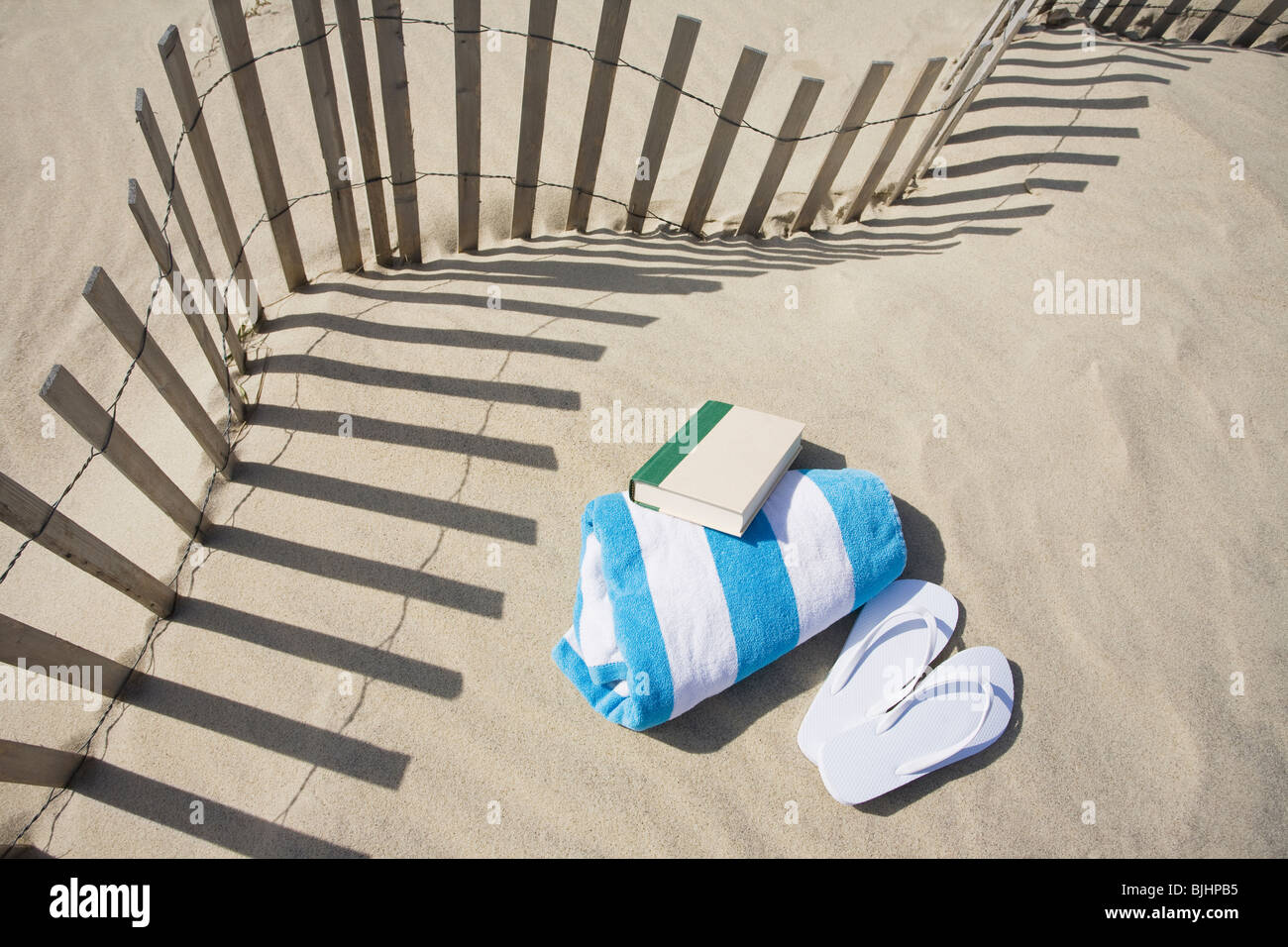 Fence on the beach - Stock Image