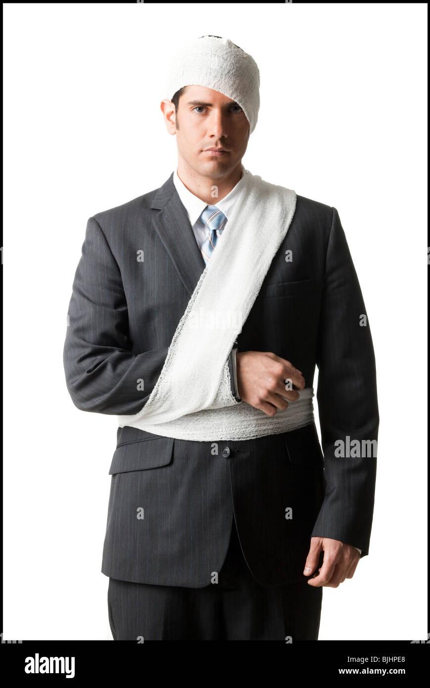 businessman with bandages on - Stock Image