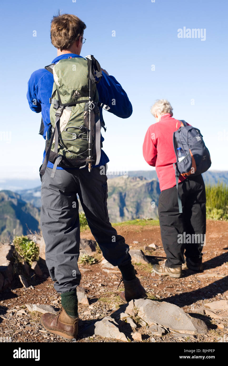 Walkers enjoy fine weather while walking on a hillside in the Madeira Islands Walking Festival. - Stock Image