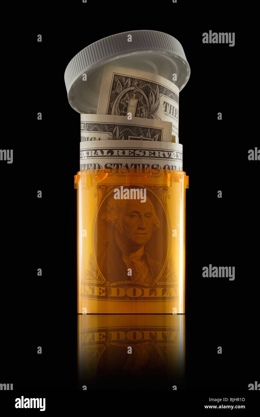 Money in prescription bottle - Stock Image