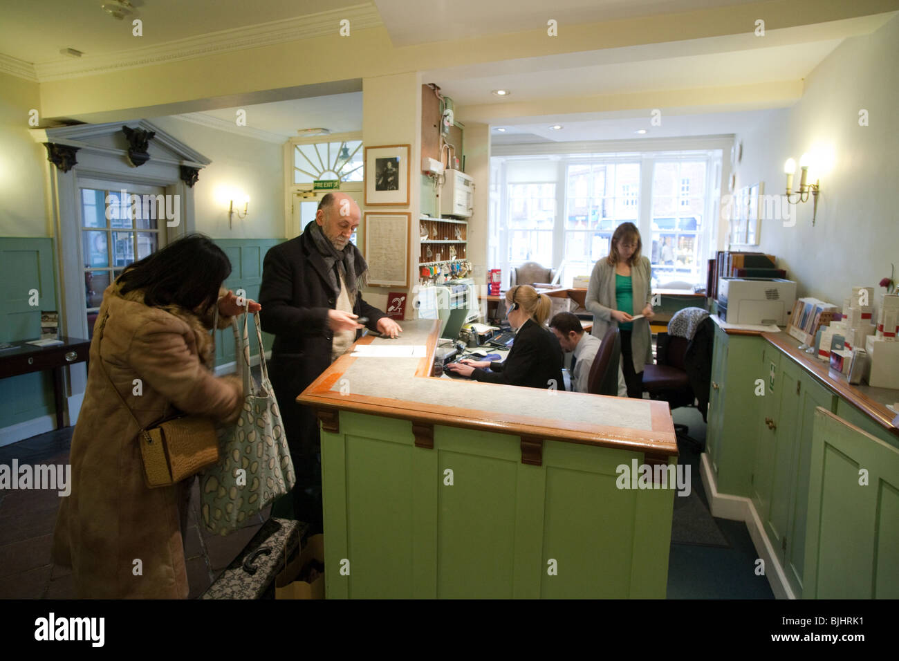 Guests checking in at the Reception, the Swan Hotel, Southwold, Suffolk, UK - Stock Image