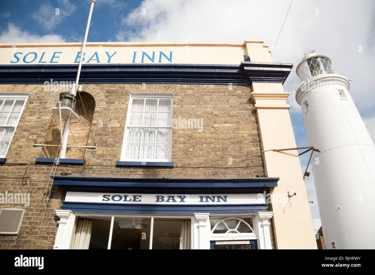 The Sole Bay Inn, and lighthouse, Southwold, Suffolk UK - Stock Image