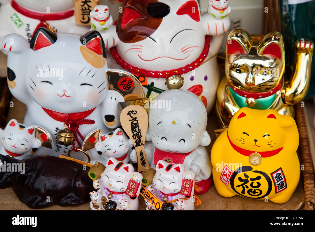 Maneki Neko literally 'Beckoning Cat'; is also known as Welcoming Cat, Lucky Cat, Money cat, or Fortune - Stock Image